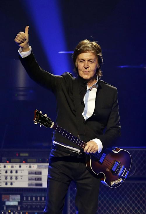 "FILE - This May 18, 2013 file photo shows Paul McCartney performing during the first U.S concert of his ""Out There!"" world tour in Orlando, Fla. The tour wraps on Aug. 14 in Canada. (AP Photo/John Raoux, file)"