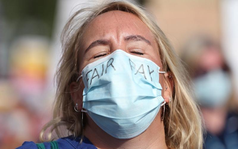 NHS workers who took to the streets across the UK on Saturday to demand better wages - Yui Mok/PA