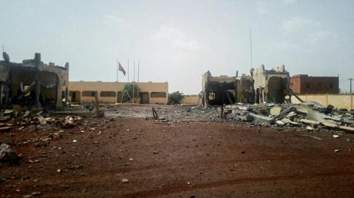Debris lies scattered in front of the headquarters of the G5 Sahel anti-terror force at Sevare in central Mali, after a sucide bomber tried to get on to the base on June 29