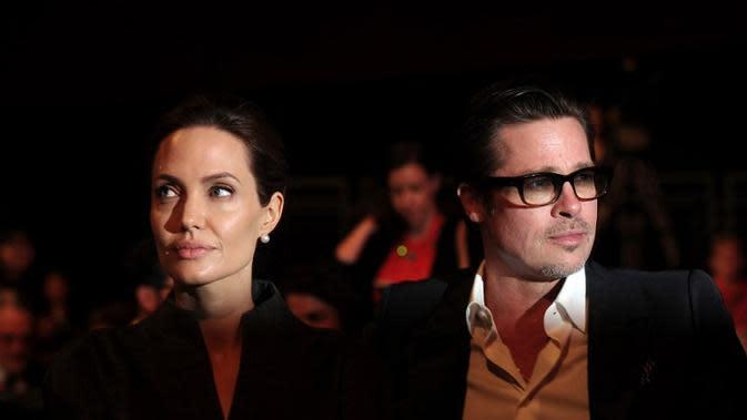 Perceraian Angelina Jolie dan Brad Pitt belum juga usai. (CARL COURT AFP)