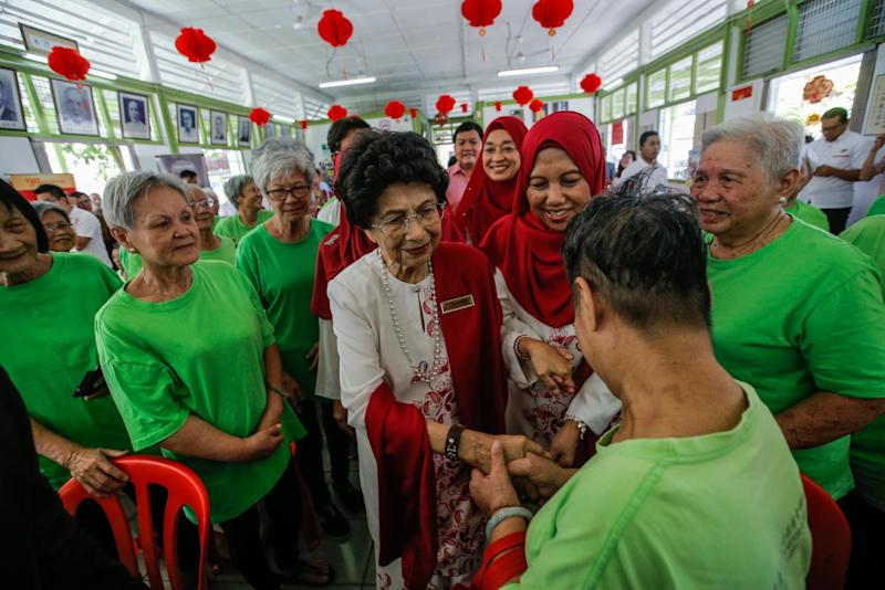 Tun Dr Siti Hasmah Mohamad Ali (centre) attends the Chinese New Year celebration at King George V Old Folks' Home Kuala Lumpur on January 28, 2020. — Picture by Hari Anggara