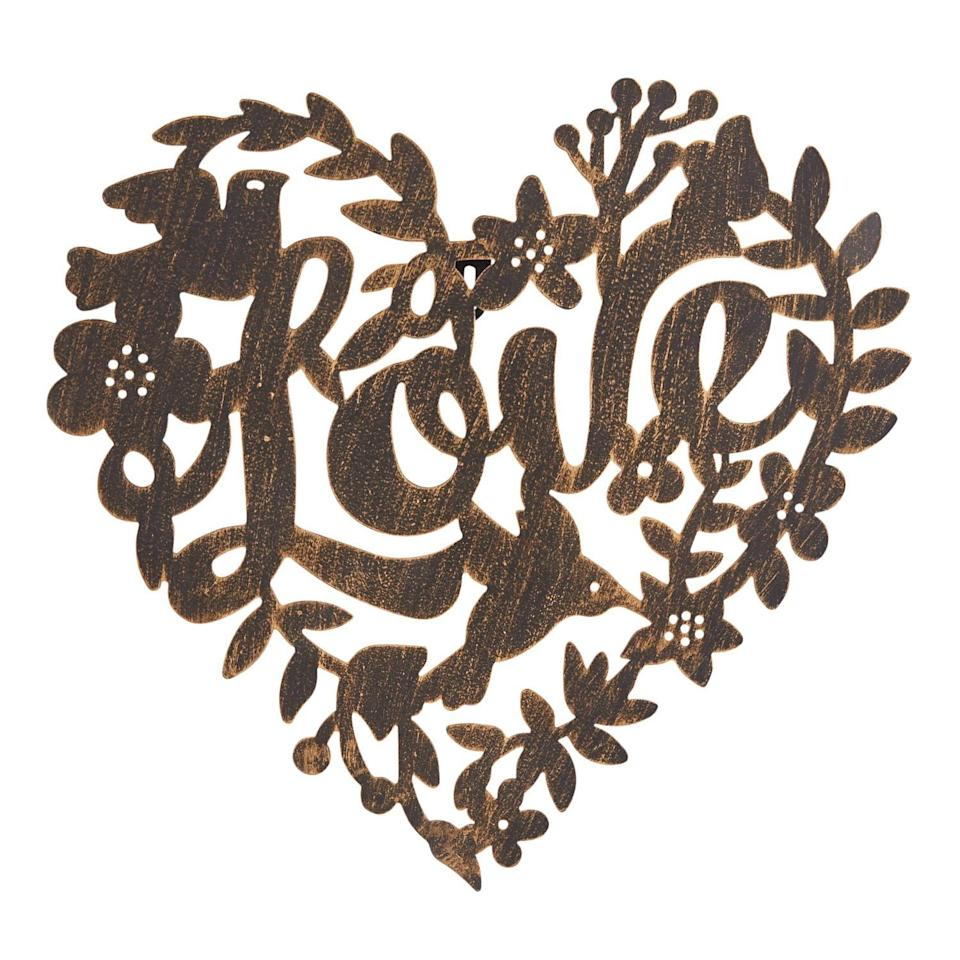 "<p>We love how intricate this <a rel=""nofollow"" href=""https://www.popsugar.com/buy/Bronze%20Metal%20Love%20Heart%20Wall%20Decor-404471?p_name=Bronze%20Metal%20Love%20Heart%20Wall%20Decor&retailer=pier1.com&price=20&evar1=moms%3Aus&evar9=45663736&evar98=https%3A%2F%2Fwww.popsugar.com%2Fmoms%2Fphoto-gallery%2F45663736%2Fimage%2F45663969%2FBronze-Metal-Love-Heart-Wall-Decor&list1=shopping%2Cvalentines%20day%2Cdecor%20shopping%2Cpier%201%20imports&prop13=mobile&pdata=1"" rel=""nofollow"">Bronze Metal Love Heart Wall Decor</a> ($20) is.</p>"