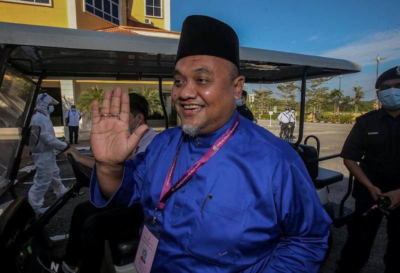 Barisan Nasional candidate Mohd Zaidi Aziz arrives at the nomination centre in Tanjung Malim August 15, 2020.