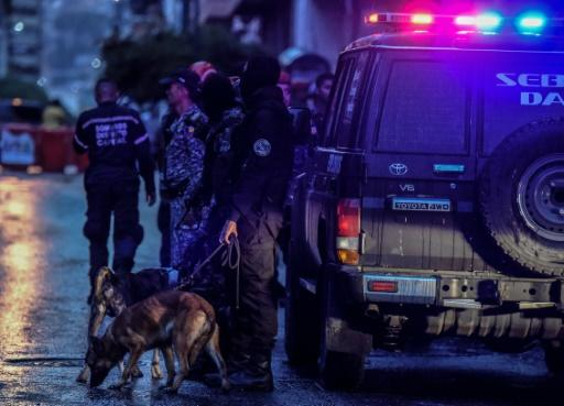 """Venezuelan security forces check a nearby building after the alleged """"assassination"""" attempt on Maduro"""