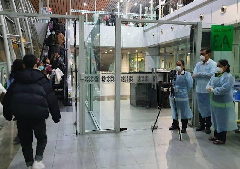Travellers being screened by Health Ministry officials at the Kuala Lumpur International Airport January 23, 2020. — Picture via Facebook/ Noor Hisham Abdullah