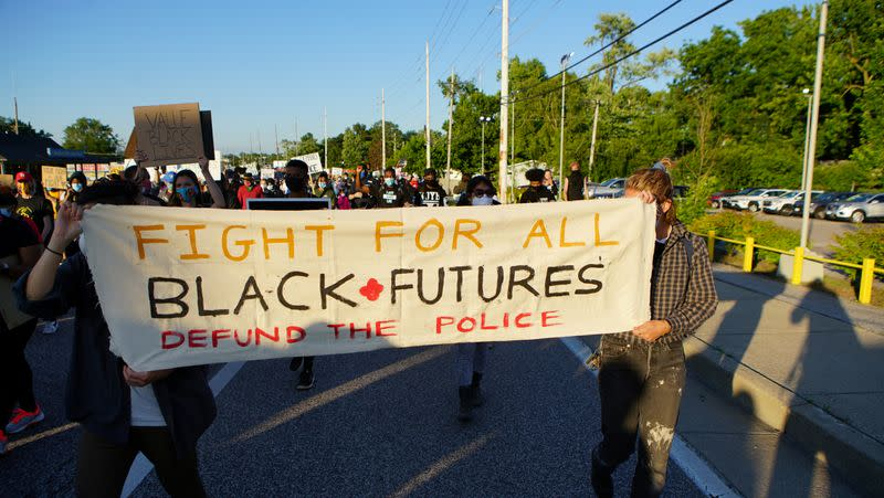 FILE PHOTO: Protest against police brutality of a man hit by a Florissant detective and death in Minneapolis police custody of George Floyd in Florissant, Missouri