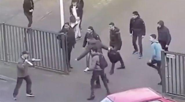 After falling over, the man got back on his feet and waved two large knives around. Source: LiveLeak