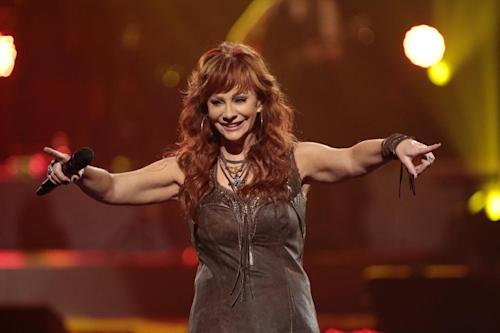 This image released by NBC Universal shows country singer Reba McEntire during the Healing in the Heartland: Relief Benefit Concert at the Chesapeake Energy Arena in Oklahoma City, Okla., Wednesday, May 29,2013. Funds raised by the benefit will go to the United Way of Central Oklahoma, for recovery efforts for those affected by the May 20 tornado. (AP Photo/NBC, Brett Deering)