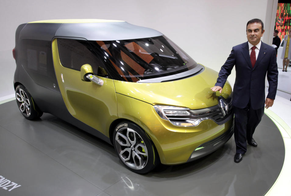"Renault-Nissan CEO Carlos Ghosn poses besides Renault's concept car ""Frendzy"" during the press day of the Frankfurt Auto Show IAA in Frankfurt, Germany, Tuesday, Sept. 13, 2011. The fair opens its doors to the public Sept. 15 to Sept. 25, 2011. (AP Photo/dapd, Martin Oeser)"