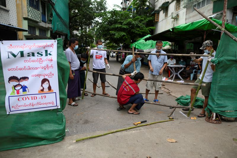 Myanmar residents barricade city streets as coronavirus cases rise