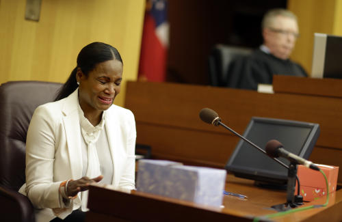 Tameka Foster Raymond, left, reacts after the playing of a 911 tape from when her son got caught in a pool drain during a child custody hearing with her ex-husband, R&B singer Usher, Friday, Aug. 9, 2013, in Atlanta. A judge in Atlanta is set to hear arguments in the child custody battle between Usher and his ex-wife. Tameka Foster Raymond requested the hearing earlier this week after the former couple's son got caught in a pool drain while in the care of the Grammy winner's aunt. (AP Photo/David Goldman)