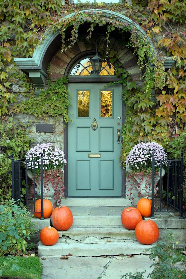 """<p>If your home's exterior already boasts a standout hue and lush greenery, keep your Halloween decor simple. No-frills pumpkins on either side of your steps will do the trick.</p><p><a class=""""body-btn-link"""" href=""""https://go.redirectingat.com?id=74968X1596630&url=https%3A%2F%2Fwww.wayfair.com%2Fdecor-pillows%2Fpdp%2Faugust-grove-long-stem-pumpkin-agtg3415.html&sref=https%3A%2F%2Fwww.goodhousekeeping.com%2Fholidays%2Fhalloween-ideas%2Fg32948621%2Fhalloween-door-decorations%2F"""" target=""""_blank"""">SHOP LONG-STEM PUMPKINS</a></p>"""