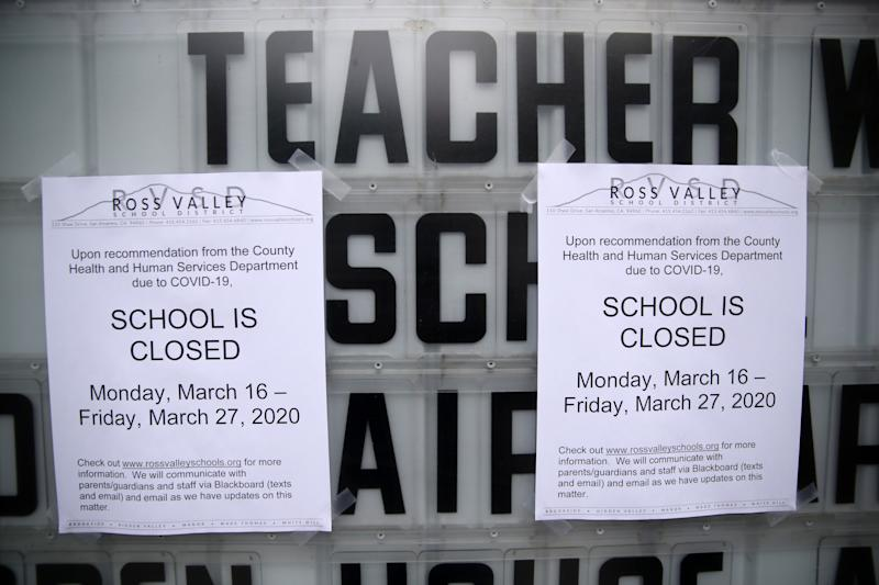 A message board outside of Brookside Elementary school is covered over with signs announcing the school is closed on March 17, 2020