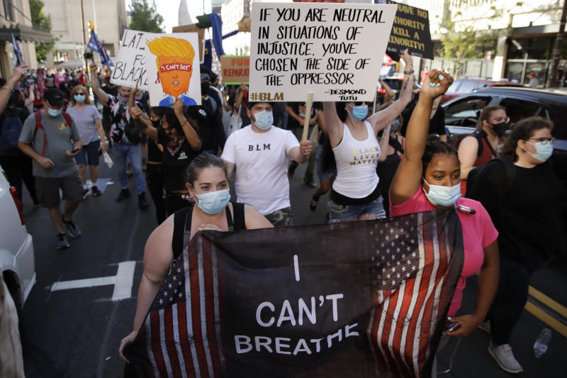 Demonstrators march near the BOK Center where President Trump will hold a campaign rally in Tulsa, Okla., Saturday, June 20, 2020. (AP Photo/Charlie Riedel)