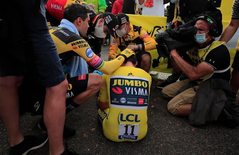 Team Jumbo rider Slovenias Primoz Roglic wearing the overall leaders yellow jersey down rests after crossing the finish line at the end of the 20th stage of the 107th edition of the Tour de France cycling race a time trial of 36 km between Lure and La Planche des Belles Filles on September 19 2020 Photo by Christophe Petit Tesson various sources AFP Photo by CHRISTOPHE PETIT TESSONAFP via Getty Images