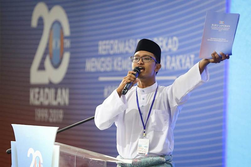 Perak delegate Mohamad Rukhairil Aizat Mohd Maharani speaks during the 2019 PKR Youth Congress at the Classic Ballroom at MITC in Melaka December 6, 2019. ― Picture by Yusof Mat Isa