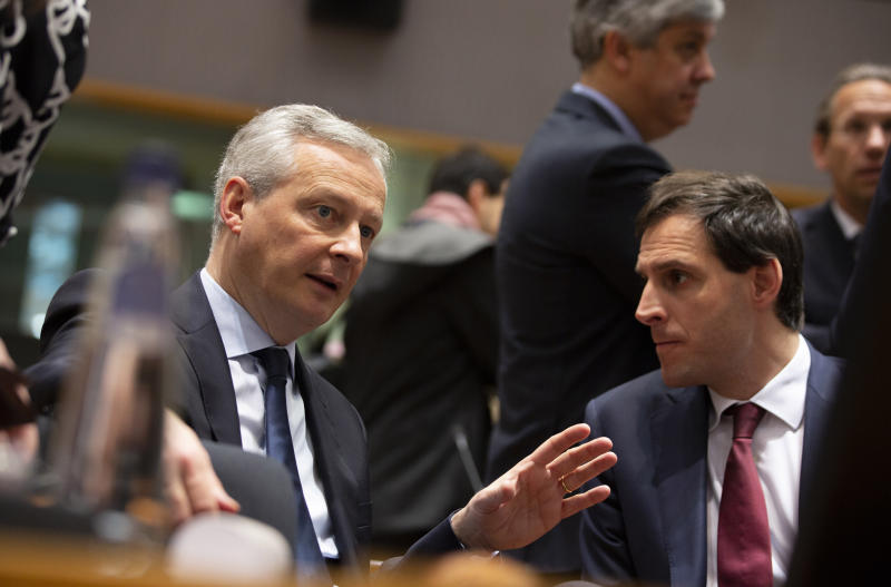 French Finance Minister Bruno Le Maire, left, speaks with Dutch Finance Minister Wopke Hoekstra during a meeting of EU finance ministers at the Europa building in Brussels, Tuesday, Feb. 18, 2020. EU finance ministers meet Tuesday to discuss tax havens. (AP Photo/Virginia Mayo)