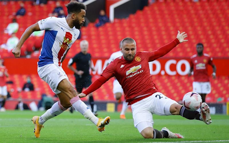 Crystal Palace's English midfielder Andros Townsend (L) shoots to score the opening goal as Manchester United's English defender Luke Shaw (R) tries to block during the English Premier League football match between Manchester United and Crystal Palace - Richard Heathcote/AFP
