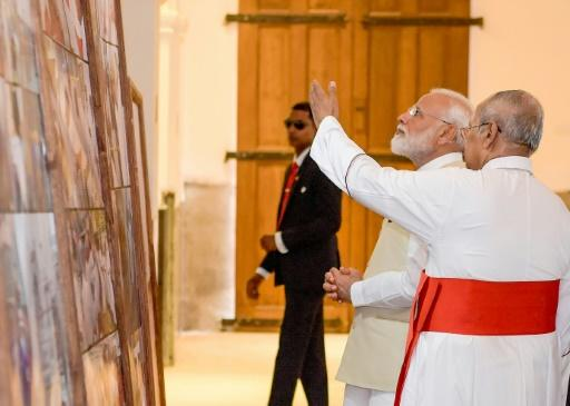 The Archbishop of Colombo, Cardinal Malcolm Ranjith, gives Indian Prime Minister Narendra Modi a tour of one of the Sri Lanka churches hit in the Easter suicide attacks