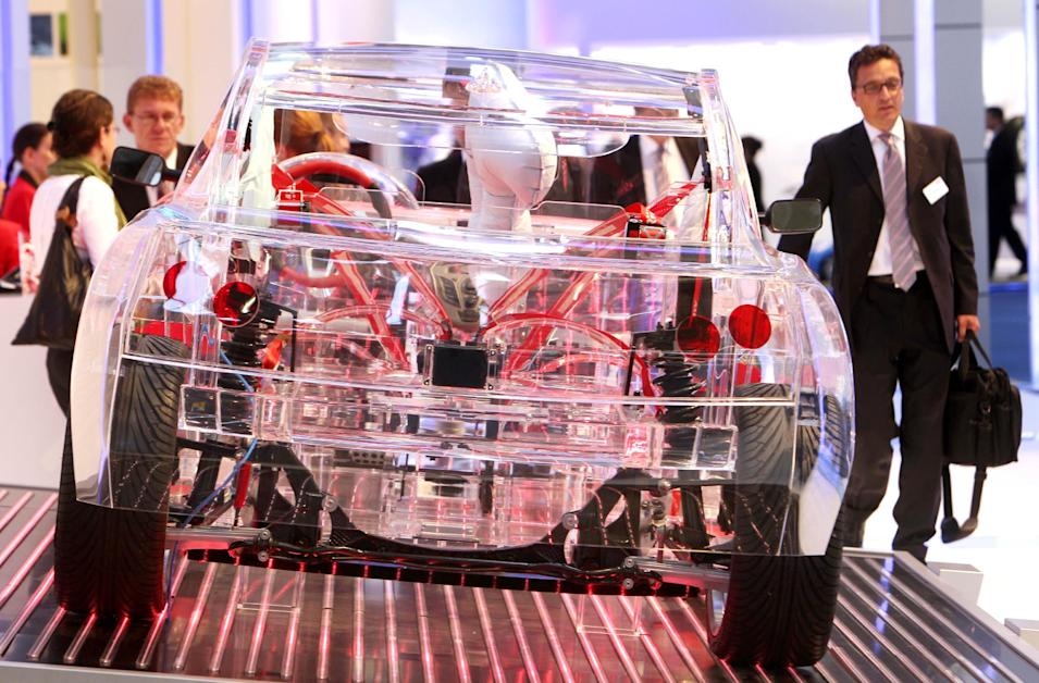 Components for security are displayed in a transparent car at the 64th Frankfurt Auto Show in Frankfurt, Germany, Wednesday, Sept.14, 2011. (AP Photo/Michael Probst)