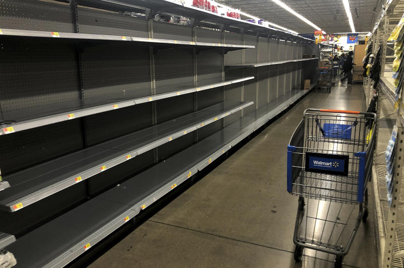 This photo shows the toilet paper aisle with empty shelves at Walmart on Friday, March 13, 2020, in San Leandro, Calif. Officials said Friday the  Los Angeles Unified School District and San Diego school districts will close starting March 16 because of the coronavirus threat.(AP Photo/Ben Margot)