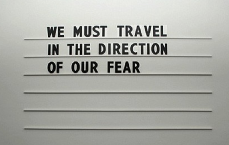 The cover photo on the woman's Facebook profile showing a phrase about travel. Source: Facebook