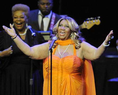 FILE - This July 25, 2012 file photo shows Aretha Franklin performing at the NOKIA Theatre L.A. LIVE in Los Angeles. Franklin will be headlining the annual McDonald's Gospelfest at the Prudential Center in Newark, N.J. on Saturday, May 11, 2013, but she's also preparing for something else big this weekend: a meeting about her upcoming biopic. The 71-year-old singer said in an interview Thursday, May 9, 2013, that she's holding a meeting to figure out the plans for the film, which has been in the works for years. (Photo by Chris Pizzello/Invision/AP, file)