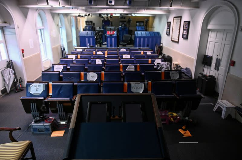 FILE PHOTO: The White House briefing room is dark and empty after the coronavirus task force did not hold a briefing for the second day in a row in Washington