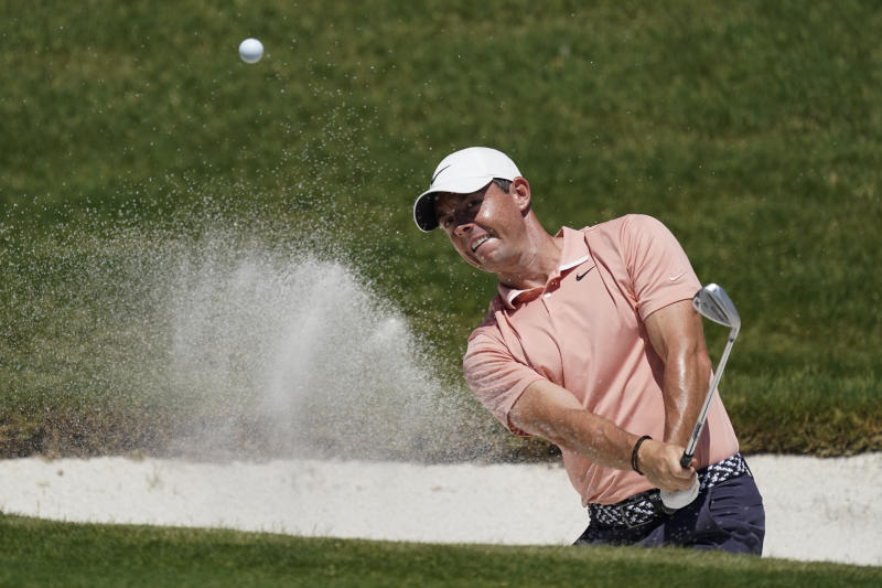 Rory McIlroy, of Northern Ireland, chips into the hole for a birdie on the 16th green during the final round of the Charles Schwab Challenge golf tournament at the Colonial Country Club in Fort Worth, Texas, Sunday, June 14, 2020. (AP Photo/David J. Phillip)