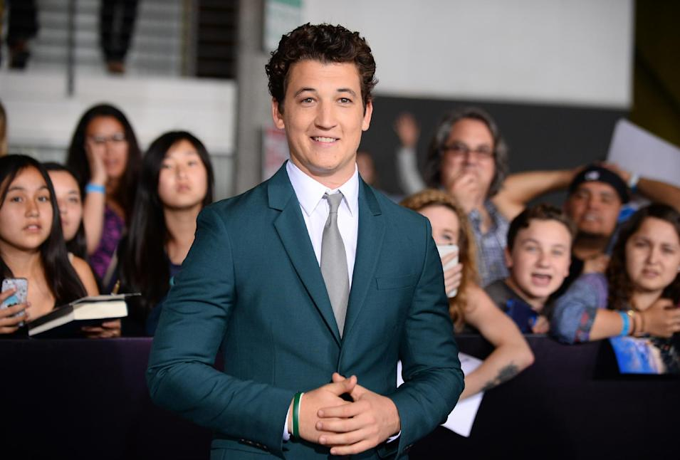 "Miles Teller arrives at the world premiere of ""Divergent"" at the Westwood Regency Village Theater on Tuesday, March 18, 2014, in Los Angeles. (Photo by Jordan Strauss/Invision/AP)"
