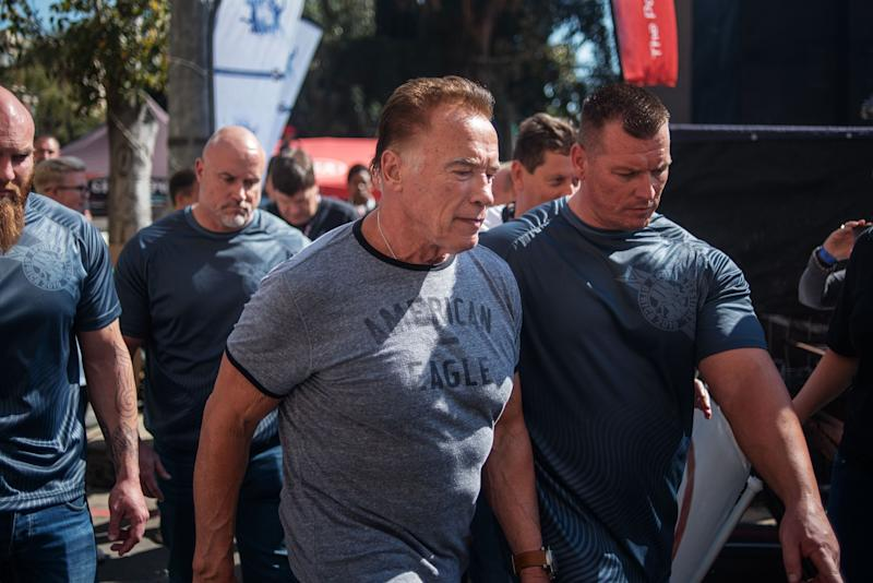 US actor and former California Governor Arnold Schwarzenegger (C) is seen at the Arnold Classic Africa, a multi-sport festival held at the Sandton Convention Centre on May 18, 2019 in Johannesburg, South Africa. (Photo by Michele Spatari / AFP) (Photo credit should read MICHELE SPATARI/AFP/Getty Images)