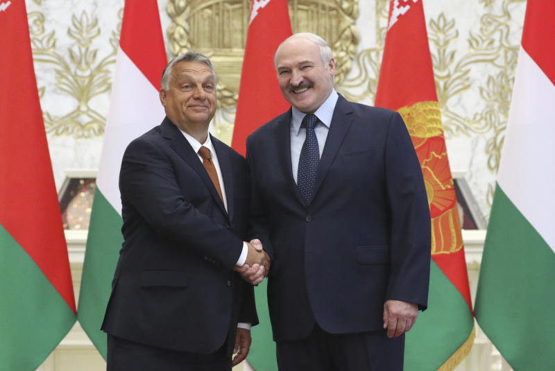 Belarusian President Alexander Lukashenko, right, and Hungarian Prime Minister Viktor Orban pose for photo during their meeting in Minsk, Belarus, Friday, June 5, 2020. (Maxim Guchek/BelTA Pool Photo via AP)