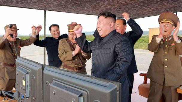 PHOTO: In this undated photo distributed on Sept. 16, 2017, by the North Korean government, leader Kim Jong Un, center, celebrates what was said to be the test launch of an intermediate range Hwasong-12 missile at an undisclosed location in North Korea. (Korean Central News Agency/Korea News Service via AP)