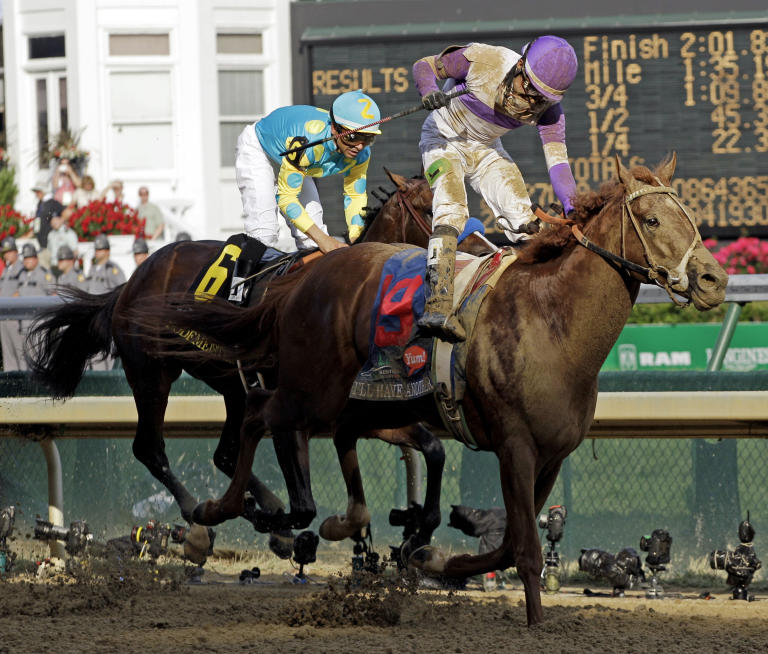 Jockey Mario Gutierrez rides I'll Have Another to victory past Bodemeister ridden by Mike Smith (6) to victory in the 138th Kentucky Derby horse race at Churchill Downs Saturday, May 5, 2012, in Louisville, Ky. (AP Photo/Mark Humphrey)
