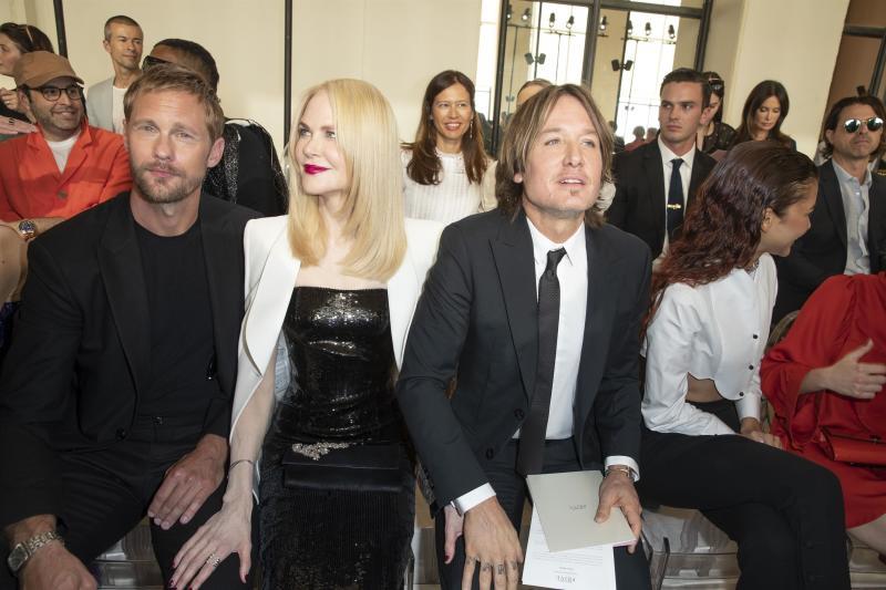A photo of Nicole Kidman, Alexander Skarsgard and Keith Urban at the Giorgio Armani fashion show in Paris.