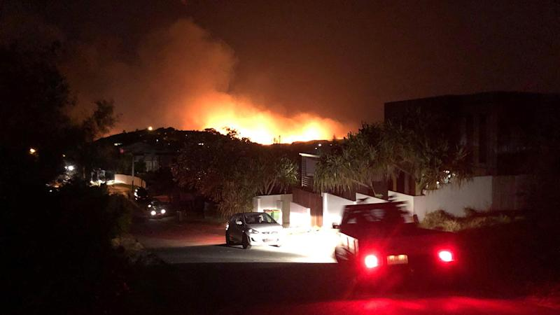 Hundreds of residents have evacuated from Peregian Springs, Queensland as bushfires rage in the area. Source: AAP