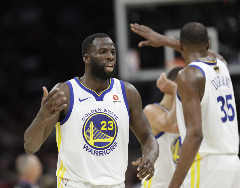 Golden State Warriors' Draymond Green and Kevin Durant celebrate during the second half of Game 4 of basketball's NBA Finals against the Golden State Warriors, Friday, June 8, 2018, in Cleveland. (AP Photo/Tony Dejak)