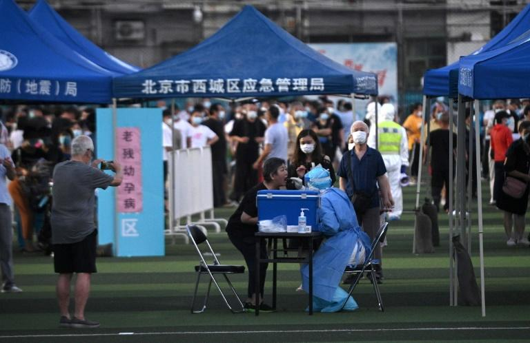 Mass testing at a market in Beijing after a fresh outbreak