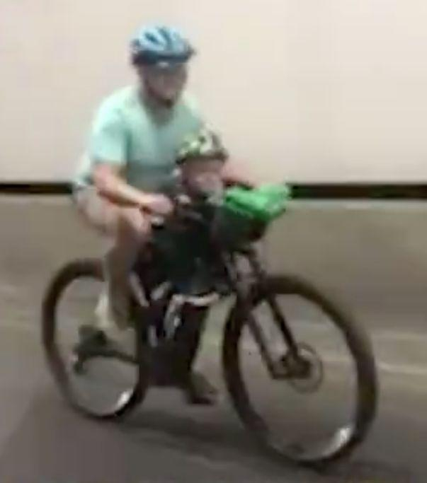 The man on a bike with a child was filmed pedalling in Sydney's Lane Cove Tunnel as other drivers passed by.