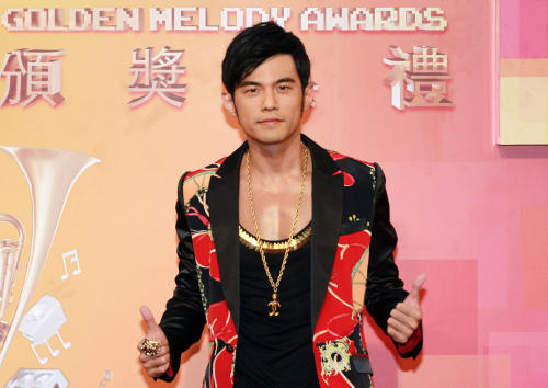 "FILE - In this July 6, 2013 file photo, Taiwanese singer Jay Chou arrives for the 24th Golden Melody Awards in Taipei, Taiwan. Chou wasn't afraid to spend money to make his second directorial feature, ""The Rooftop,"" into a work of art. Nor is the Taiwanese superstar afraid of addressing criticism of his acting, something for which he has been berated ever since 2007's ""Secret."" He says he's more open now and acting has become more natural for him. (AP Photo/Wally Santana, File)"