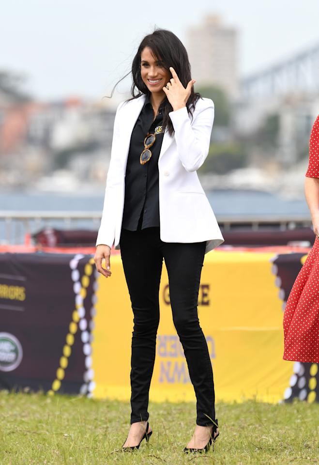 <p>The Duchess of Sussex wore a casual and comfortable outfit for the first event of the Invictus Games on day five of the royal tour. Source: Getty </p>