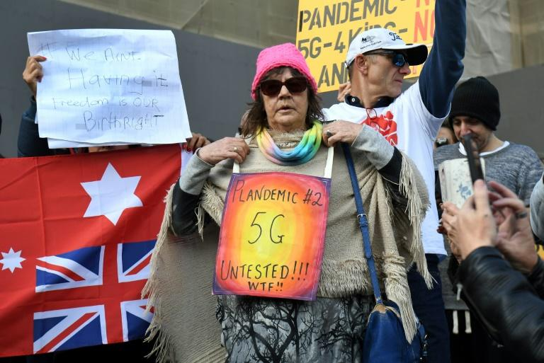 About 150 protesters rallied outside Victoria's state parliament to protest against a shutdown aimed at stemming the spread of COVID-19, while also peddling conspiracy theories about the virus