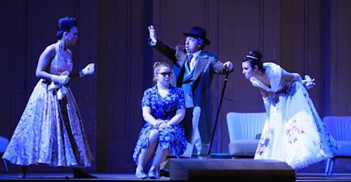 "FILE - In this Jan. 22, 2013 file photo Margarita Gritskova in the role of Tisbe, Tara Erraught as Angelina, Alessandro Corbelli as Don Magnifico and Valentina Nafornita as Clorinde, from left, perform during a dress rehearsal for the opera ""La Cenerentola"" by Gioachino Rossini, at the state opera in Vienna, Austria. There is no pumpkin-turned-coach on the stage, no glass slipper, no fairy godmother, and the action takes place in an imaginary Italian duchy in the 1950s. But Gioachino Rossini's take on Cinderella remains utterly magical in the new version being put on by the Vienna State Opera with the premiere on Sunday Jan. 27, 2013. (AP Photo/dapd, Lilli Strauss,File)"
