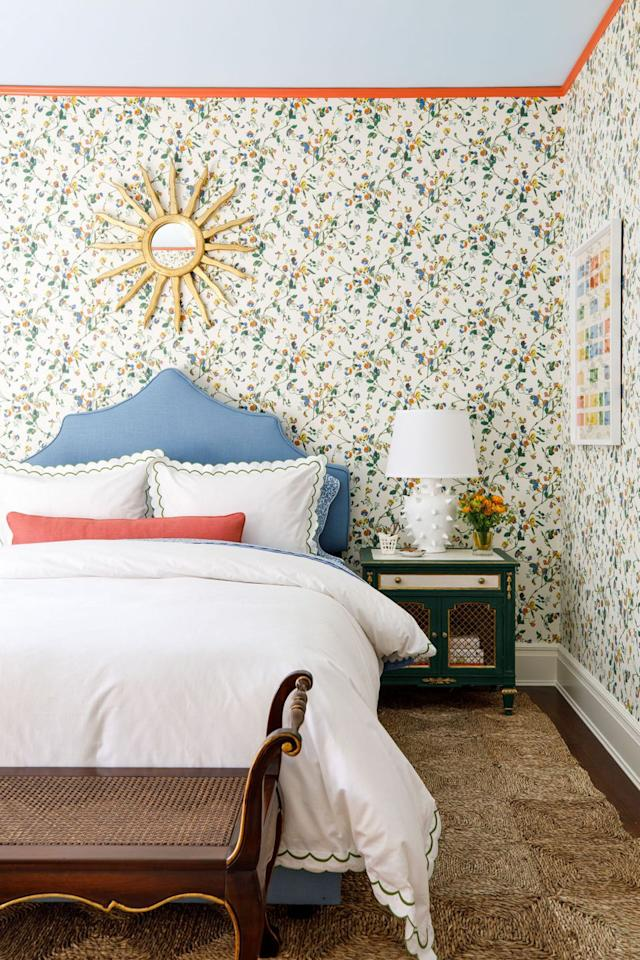 """<p>This vintage-inspired floral wallpaper from <a href=""""https://www.cole-and-son.com/en/"""" target=""""_blank"""">Cole & Sons</a> set the stage for this fabulous guest bedroom, designed by <a href=""""https://www.cynthiamcculloughinteriors.com/"""" target=""""_blank"""">Cynthia McCullough Interiors</a>. Adding a matching sky blue upholstered bed and bright salmon-colored accents offers a visual feast for the eyes, while a mix of vintage pieces evokes countryside charm. </p>"""