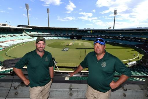 Green grass of home: Curators Adam Lewis (right) and Justin Groves at the Sydney Cricket Ground