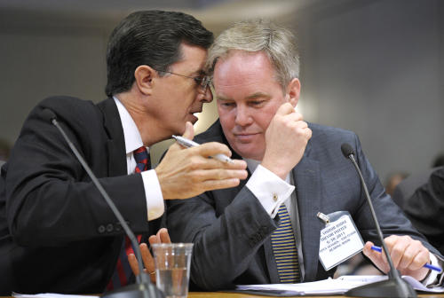 "Comedian Stephen Colbert, left, confers with his attorney Trevor Potter, as he testified before the Federal Election Commission in Washington, Thursday, June 30, 2011. Colbert, who plays a conservative TV pundit on ""The Colbert Report,"" wants to launch Colbert Super PAC, a type of political action committee that would allow him to raise unlimited amounts of money from corporations, unions and individuals to support or oppose candidates in the 2012 elections through independent expenditures such as TV ads. (AP Photo/Cliff Owen)"