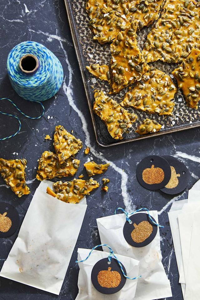 """<p>This sweet treat is trickier than your standard kid-friendly fare. Roasted pepitas, herbs, a generous pinch of salt and a dash of pepper give it a spooky mix of flavors.</p><p><strong><a href=""""https://www.countryliving.com/food-drinks/a33944366/rosemary-pumpkin-seed-brittle/"""" target=""""_blank"""">Get the recipe</a>.</strong></p><p><strong><a class=""""body-btn-link"""" href=""""https://www.amazon.com/Nordic-Ware-Natural-Aluminum-Commercial/dp/B0049C2S32/?tag=syn-yahoo-20&ascsubtag=%5Bartid%7C10050.g.454%5Bsrc%7Cyahoo-us"""" target=""""_blank"""">SHOP BAKING SHEETS</a><br></strong></p>"""