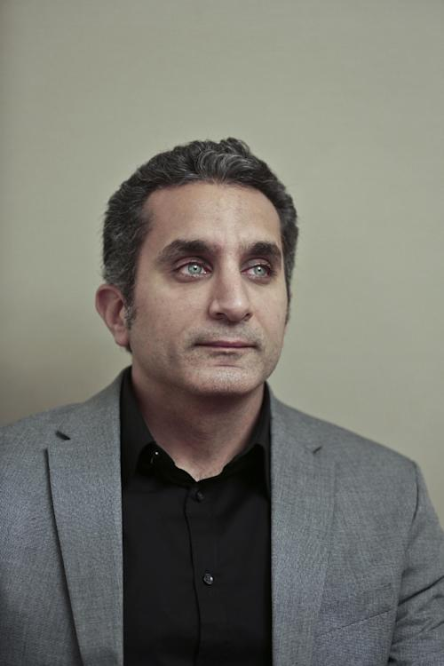 Egyptian satirist Bassem Youssef poses for a photograph at his studio in downtown Cairo, Egypt, Wednesday, Jan. 8, 2014. Youssef, often compared to U.S. comedian Jon Stewart, says his team will bring back its popular television show poking fun at politics in a country still beset by turmoil following a July military coup. However, he acknowledged the challenges facing him and others in Egypt now in an interview with The Associated Press. (AP Photo / Nariman El-Mofty)