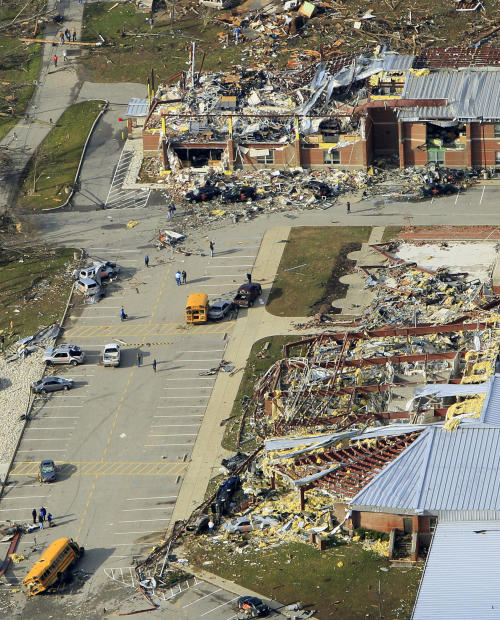 FILE - In this March 3, 2012, file photo, is the Henryville Jr./Sr. High School in Henryville, Ind., after a tornado swept through town. Students from the wrecked school awaited word Tuesday, March 20, 2012, about whether on online campaign supported by other schools in their state and beyond will land them a prom-night performance by Grammy-winning country trio Lady Antebellum. (AP Photo/Al Behrman, File)
