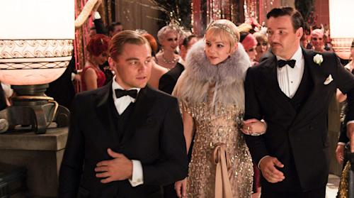 """This undated publicity photo released by courtesy Warner Bros. Pictures shows, from left, Leonardo DiCaprio as Jay Gatsby, Carey Mulligan, as Daisy Buchanan and Joel Edgerton as Tom Buchanan in Warner Bros. Pictures and Village Roadshow Pictures drama, """"The Great Gatsby,"""" a Warner Bros. Pictures release. (AP Photo/Warner Bros. Pictures)"""